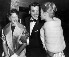 Rock Hudson, wife Phyllis Gates (married 1955-1958), shown with Grace Kelly (right) at the Beverly Hilton Hotel, Los Angeles, 1956