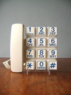 Vintage white and blue push button phone from Webcor Electronics. Super fun and funky - check out those big numbers! Circa early 80s. In good vintage