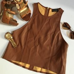 PU Leather top Racer back style. 16.5 inches across waist. Cognac colored PU leather Tops Crop Tops