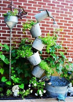 How to make a {Tipsy Solar Fountain} for your garden!
