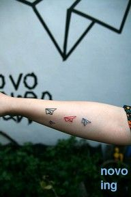 paper airplane tattoo. maybe back of shoulder placement?