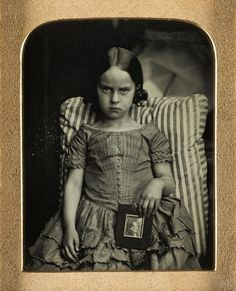 Ross and Thomson of Edinburgh : Unknown little girl sitting on a striped cushion holding a framed portrait of a man, possibly her dead father Ninth-plate daguerreotype Antique Photos, Vintage Pictures, Old Pictures, Vintage Images, Old Photos, Vintage Ads, Vintage Girls, Vintage Children, Photo Portrait
