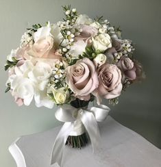 Pretty nudes and ivories for this brides bouquet. Bridal Flowers , Pretty nudes and ivories for this brides bouquet. Pretty nudes and ivories for this brides bouquet. Bridal Bouquet Blue, Cascading Wedding Bouquets, Peony Bouquet Wedding, Diy Wedding Flowers, Bride Bouquets, Bridal Flowers, Rose Wedding, Bridesmaid Bouquet, Floral Wedding