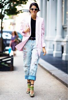 Leandra Medine of Man Repeller wearing a pastel pink long blazer and ripped jeans with the coolest green heels
