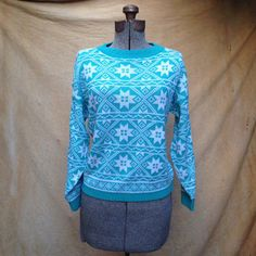 """Vintage 1980s Holiday Christmas Sweater. Snowflake Women's Medium. Need a holiday sweater, but want to wear it throughout the winter? This is the sweater.   Details Size: M Chest: 38"""" Shoulders: 21"""" Sleeve: 17"""" Length: 21.5"""" Waist: 32""""  Brand: Jolie NY, made in USA, 100% acrylic Colors: turquoise & white"""