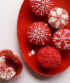 Wonderfully festive red and white snowflake decorated Red Velvet Cupcakes. #cupcake #red #velvet #cake #snowflakes #food #Christmas #winter