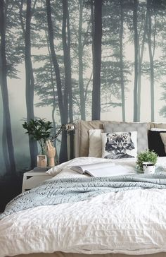 If you're into Scandi interiors, you'll love this bedroom. Soft neutrals and powder blues coordinate wonderfully with the misty forest landscape. Giving an overall dream-like feel that's perfect for bedroom spaces.