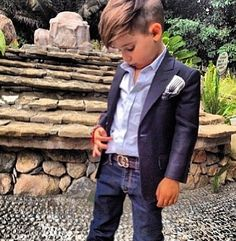 Cutest little boy! But little boys love to run and jump and play and this jacket would probably constrict movement and the shirt would end up untucked.