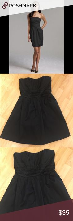 David's Bridal Strapless Bridesmaid Dress Lovely black strapless dress. Super flattering rouching on the bust and waist. Hidden pockets on each side. Shell 100% Cotton. Lining 100% Polyester. Gently used in great condition. David's Bridal Dresses Strapless