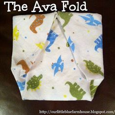 The Ava Fold: a fold with a flat section where poop is caught which is designed to keep poop contained and off the covers.