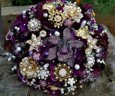 Lovely purple brooch bouquet Found on Weddingbee.com Share your inspiration today!