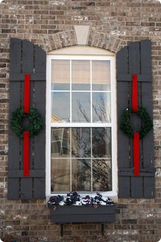 Love the way they put wreaths on the shutters. Clever.