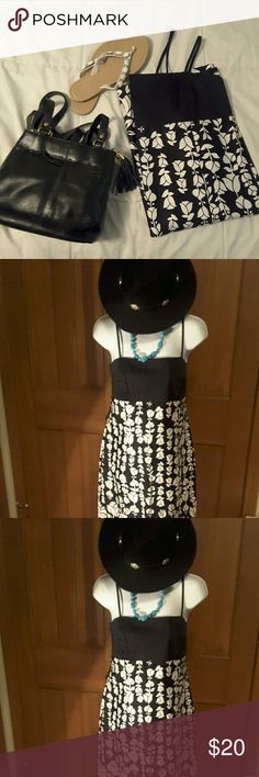 SALE!!  Black and White Sundress  by AGB Spaghetti  straps, ties in the back to show a little skin. Last pic shows back. Very becoming dress you can dress it up or down.  Worn very few times. Great condition. Average length not mini nor midi. AGB Dresses