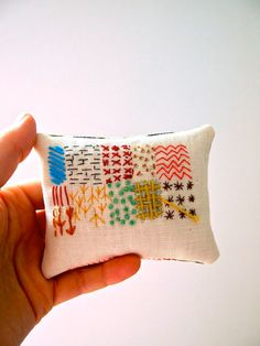 Jess Quinn:  Hand embroidered display pillow with lavender abstract