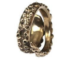 Octopus Tentacle Ring ( http://uncovet.com/designer-spotlight/moon-raven/octopus-tentacle-ring?via=HardPin=type129 )