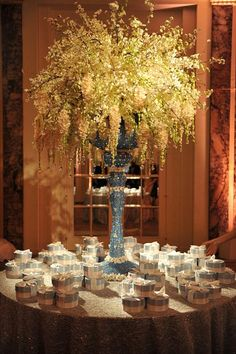 Spectacular floral designs by Preston Bailey. A centrepiece for a gift table.