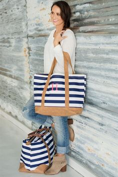 """Bold, classic colors make this cotton canvas carryall a must-have for spring and summer. Perfect for a quick trip to the park or for an everyday tote to carry all of your necessities. We just love the size and feel of this bag. A practical inside zipper pocket and embroidered monogram finish the seaside chic tote.Bag measures 21"""" L x 7"""" W x 14"""" H and is made from 16 oz. Cotton Canvas.Please be sure to add your monogram in the exact order you wish for it to appear. Traditional monograms are…"""