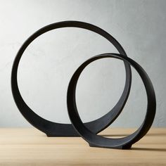 Shop Metal Ring Sculptures. Black cast aluminum circle stands firm like a piece of art, open for interpretation. Sculptural edges curve round for added visual detail. CB2 exclusive.
