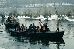 It wasn't easy to see Washington's first crossing of the Delaware on Christmas night, 1776. The whole point was to cross while night's darkness hid the boats. But nowadays, you can see the crossing in broad daylight at 1:00 p.m. every Christmas Day. About 125 reenactors stand in for Washington's 2,400 troops. They parade on the Pennsylvania side before they cross. | Reenactments of the Revolution | Kids Discover
