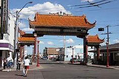 Harbin Gate, a gift from the people of Harbin, Edmonton's sister city.  (This Chinese archway architecture is called a paifang.)   The elaborate gateway, designed by a master architect from China, is constructed of eight steel columns painted the traditional Chinese red and an arch roof comprised of 11,000 tiles that were individually handcrafted and glazed in China.