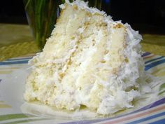 This is an old recipe wet coconut cake I don't care how old this recipe is...would you look at this slice of cake??!.
