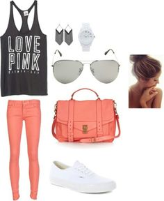 Pink jeans with a black crop top and white shoes with sunglasses,messy bun, and accessories