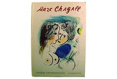 """Marc Chagall: Poster and Personality by Joseph Foster. New York: Reynea, 1966. Illustrated binding, 26 color plates. Age wear, corner bumps some spotting to cover. 10.25"""" L x 0.5"""" W x 14.25"""" H"""