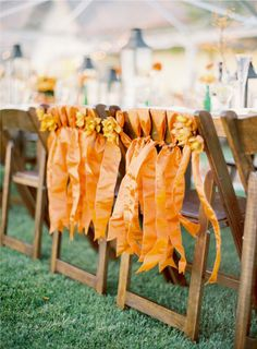 ribbons on the bride and groom's chairs  Styled by La Fleur Weddings, Photo Jose Villa