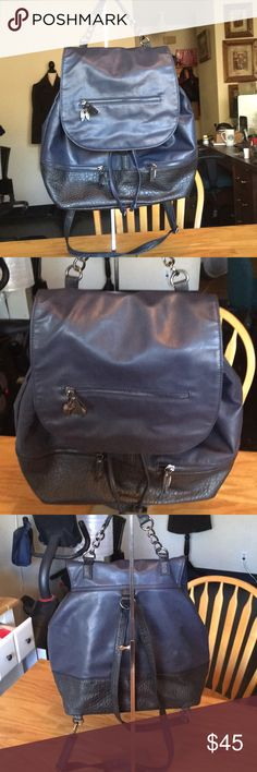 """Victoria's Secret dark blue faux leather backpack This is in excellent used condition as pictures show. May show minor signs of use being that it is a used bag but no major wear! Measurements are 13.5"""" tall and 17"""" wide. Bottom is a faux leather crocodile print and the rest of the bag is a royal blue color! Backpack comes from a non smoking environment! Thank you for looking! :) Victoria's Secret Bags Backpacks"""