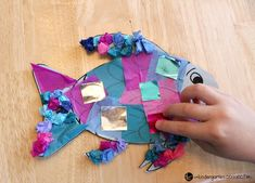 """This rainbow fish craft is the perfect companion to the beloved book """"The Rainbow Fish."""" It is so bright and colorful - kids love it! Rainbow Fish Eyfs, Rainbow Fish Activities, Rainbow Fish Crafts, Dinosaur Activities, Rainbow Art, The Rainbow Fish, Summer Activities, Toddler Activities, Fish Crafts Preschool"""