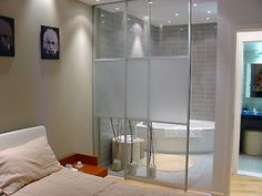 Small Bathroom ideas: Sliding glass doors in place of walls separating the bathroom from the master bedroom gives the illusion of space and creates a modern feel.