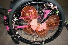 A Beautiful Butterfly and Flowers Decorate This Wheel