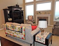 """This is basically my family room. Really wish I had seen this sooner because I love the wood """"Hallway"""" behind the couch, would have really cut down on traffic wear on the carpet. Home Sweet Quilt--living-room decor"""