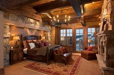 Rustic and cozy bedroom with stone fireplace. Description from pinterest.com. I searched for this on bing.com/images