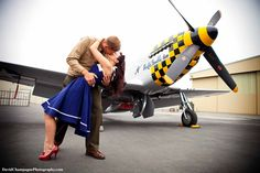 Classic 1940's themed engagement picture with airplane