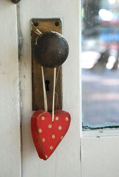 Add interest to a door knob with a polka dot hanging heart.