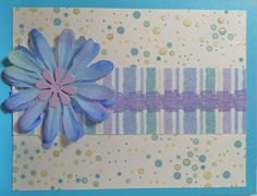 """This was one of those """"I have the background; what do I do with it? cards...I found the striped paper, then the ribbon, and finally a flower with a center that goes with the color scheme - ta da!..."""