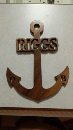 Walnut anchor with name or word scrolled in it. If interested see me at Scrollriffic Crosses on Facebook.