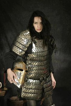 Metal lamellar armor. Might be a good way to get metal armor without all of the hammering work.