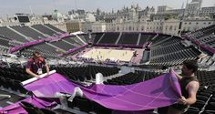 Wrapping up: Construction workers continue preparations at the beach volleyball venue