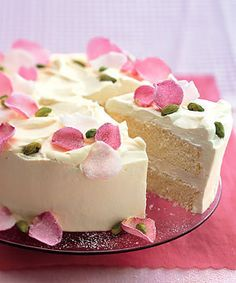 Persian Love Cake - a cardamom chiffon cake with saffron-rose whipped cream, and topped with pistachios and sugared rose petals.