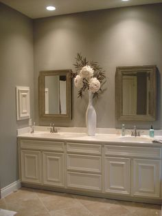 Another FAVE. Nice, soft neutral tones. Beautiful cabinets. His sides. Recessed lighting. Built in medicine cabinets on either side.