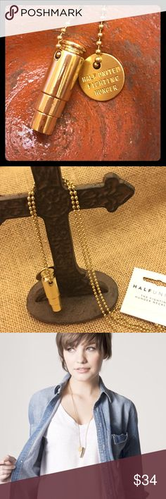"""Fighting Hunger Necklace Gold Bullet The """"Fighting Hunger"""" bullet necklaces represent your fight against global hunger using ethical fashion. We've taken something that is usually seen as a symbol of harm, and turned it into a positive symbol of hope. We're repurposing bullets for good! For every HALF UNITED product you purchase, YOU provide 7 meals for a child in need!  -Handmade in the USA -gold plated -30"""" gold ball chain -gold plated charm that reads """"HALF UNITED FIGHTING HUNGER""""…"""