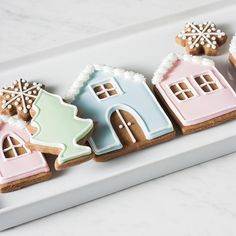 Make these adorable gingerbread house cookies using basic royal icing decorating techniques. Inspired by Peggy Porschen's pastel gingerbread house cake. https://yumgoggle.com/gingerbread-house-cookies/ Whisk + Wander
