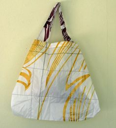 old windsurfing kites made into totes