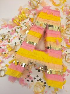 Say it with a piñata! These fringe letter piñatas are a fun way to spell out Bride, Baby mesa de regalos con nombre de bebe