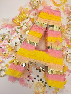 Say it with a piñata! These fringe letter piñatas are a fun way to spell out Bride, Baby mesa de regalos con nombre de bebe