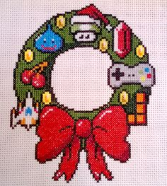 ThinkGeek's 8-bit wreath in cross stitch