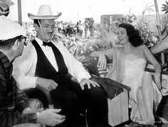 Director Mark Robson and David Niven with Ava Gardner on the set of The Little Hut
