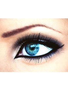 Gorgeous turquoise eye and black eyeliner.